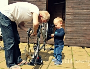 Imitate Daddy fix the bike
